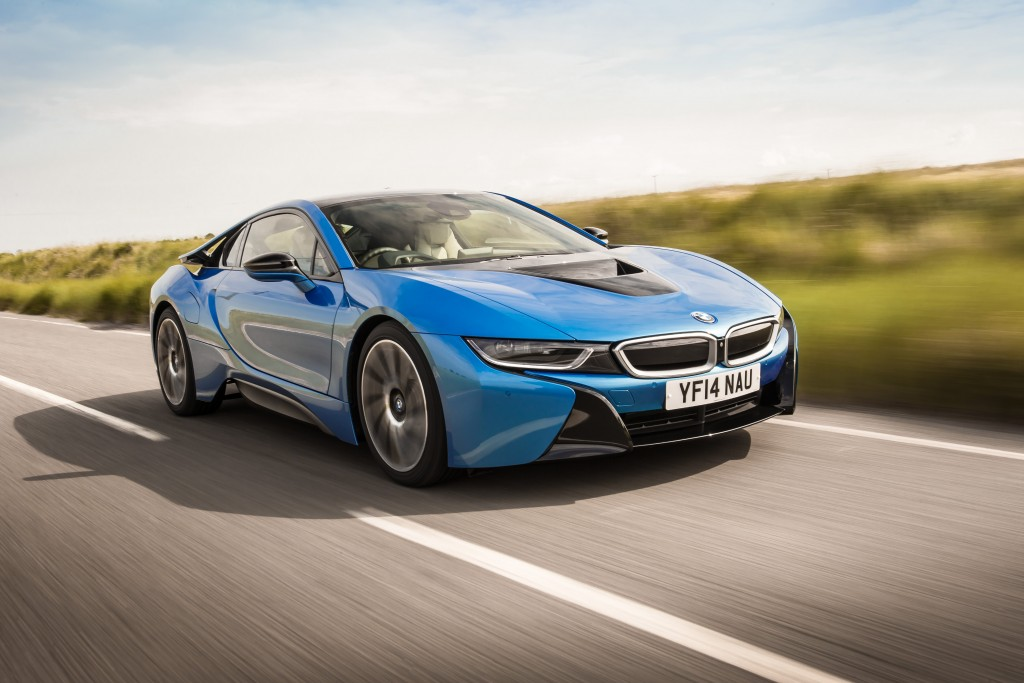 BMW i8 driving through countryside